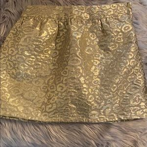 Place- gold skirt. Perfect for holiday pictures